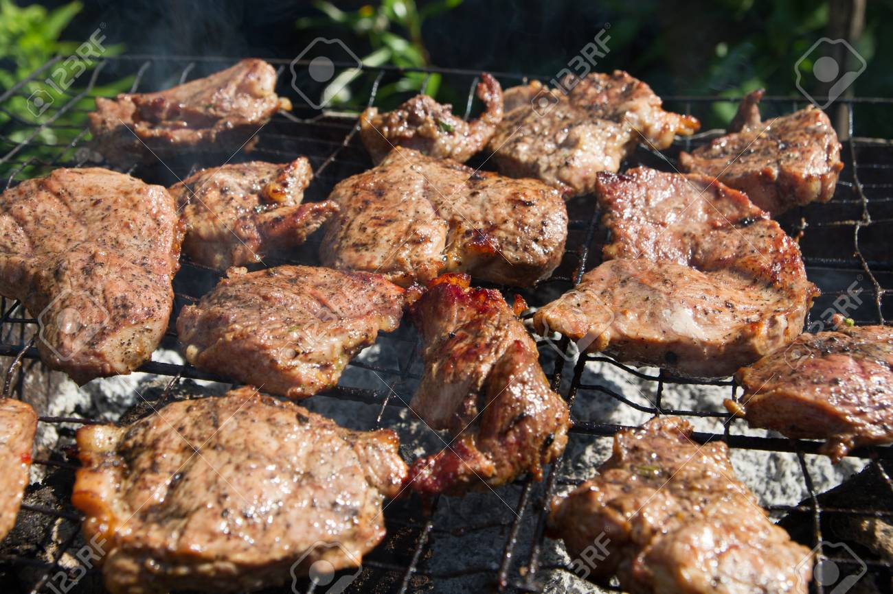 Beef Steak On The Grill, Delicious Barbecue In The Garden Stock ...