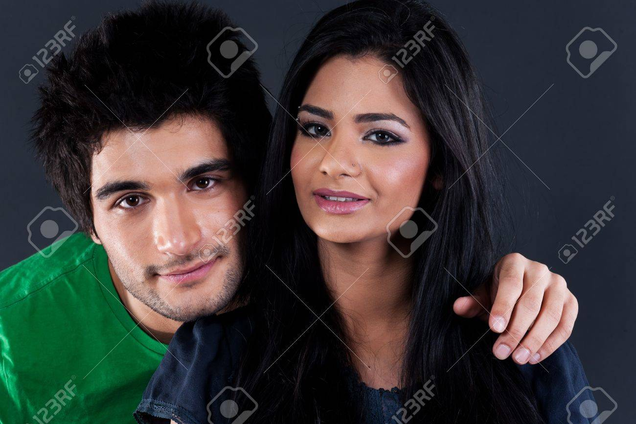 portrait of ethnic couple couple in studio, latin american man with Indian girl Stock Photo - 14221419