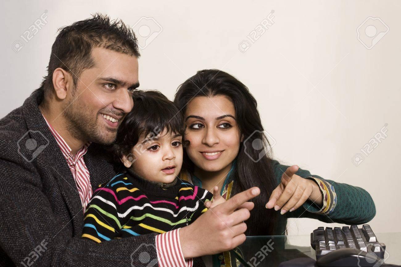 happy multi ethnic family of three enjoying together Stock Photo - 14249262