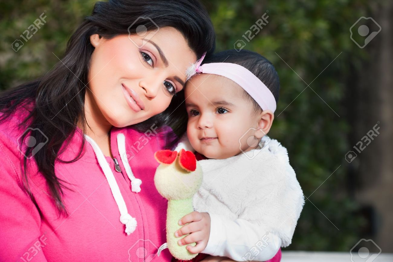 Indian family, mother holding her little daughter in arms Stock Photo - 14430998