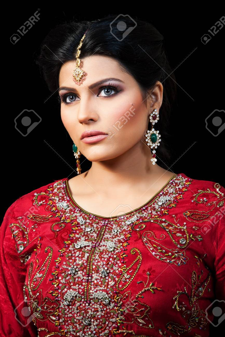 Muslim Indian bride wearing a red bridal dress, portrait of a..
