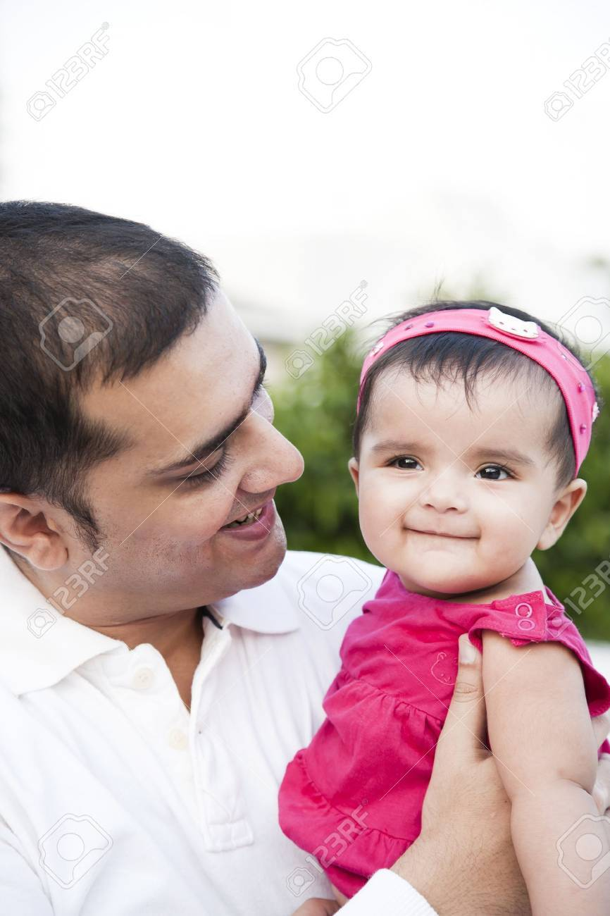 Portrait of a father holding the in his arms with love and affection Stock Photo - 15202425