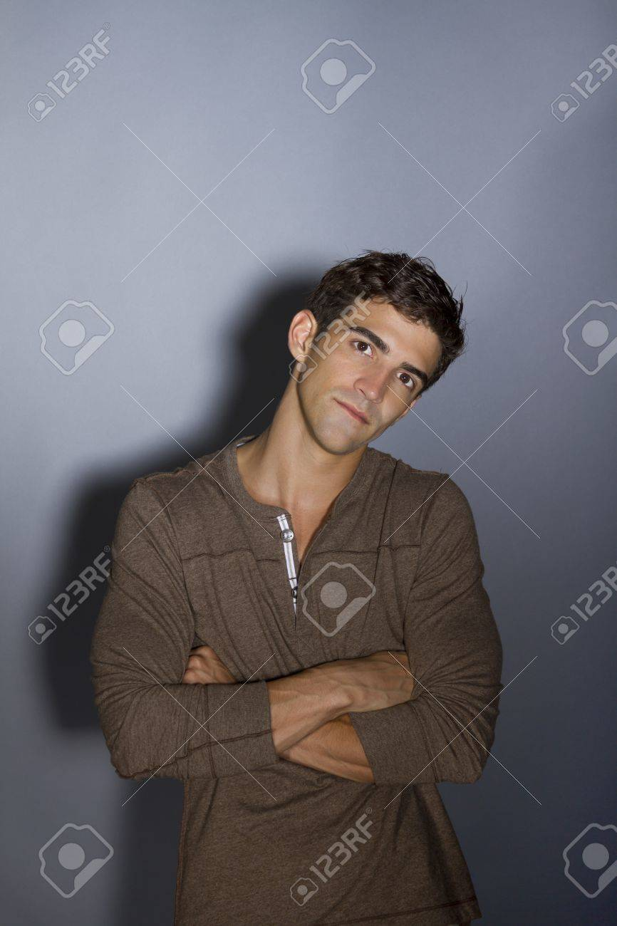 young man thinking with arms crossed Stock Photo - 12597934