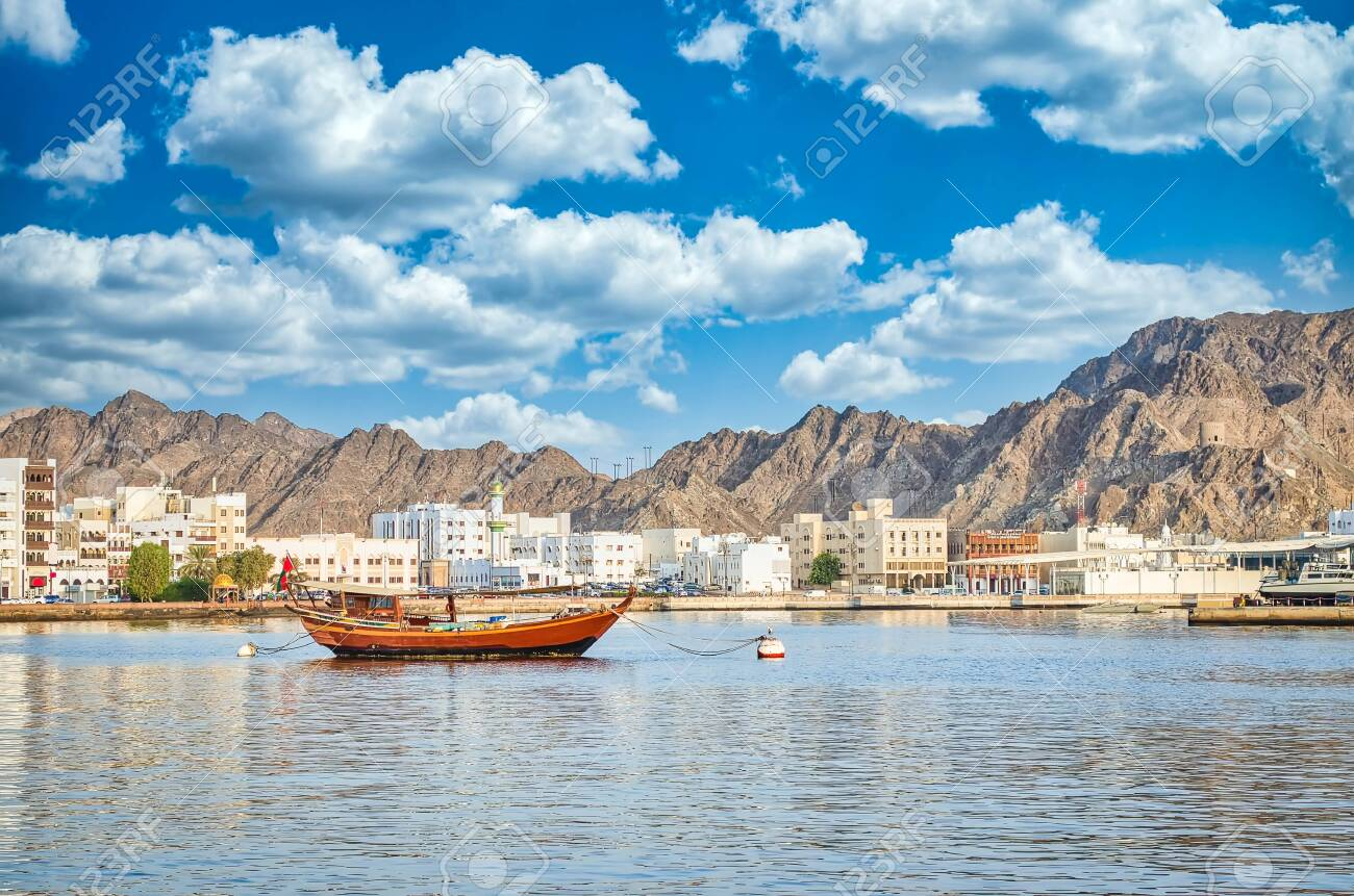 Old Sailboat anchored at Muttrah Corniche. The the old city and mountains in the background. From Muscat, Oman. - 141278658