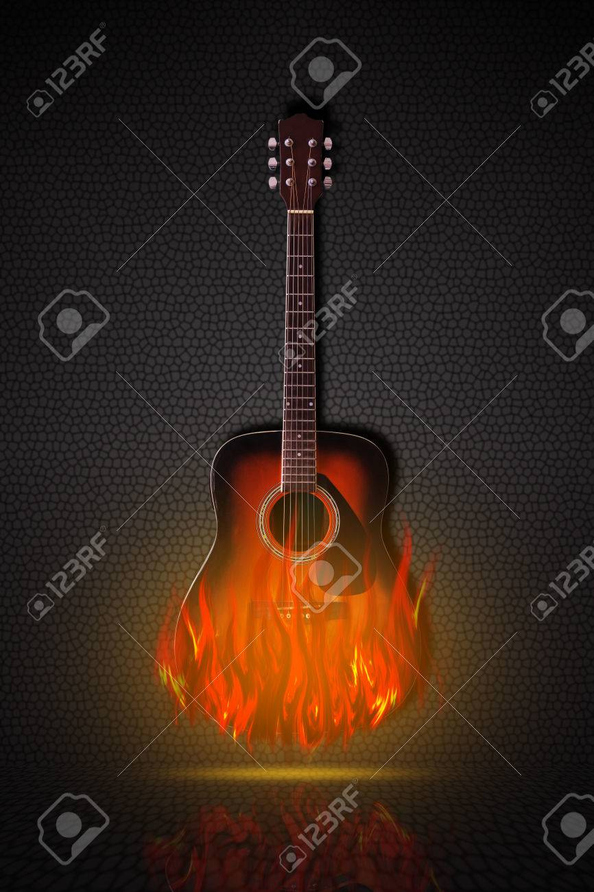 Acoustic Guitar On Fire On Black Background Stock Photo Picture And