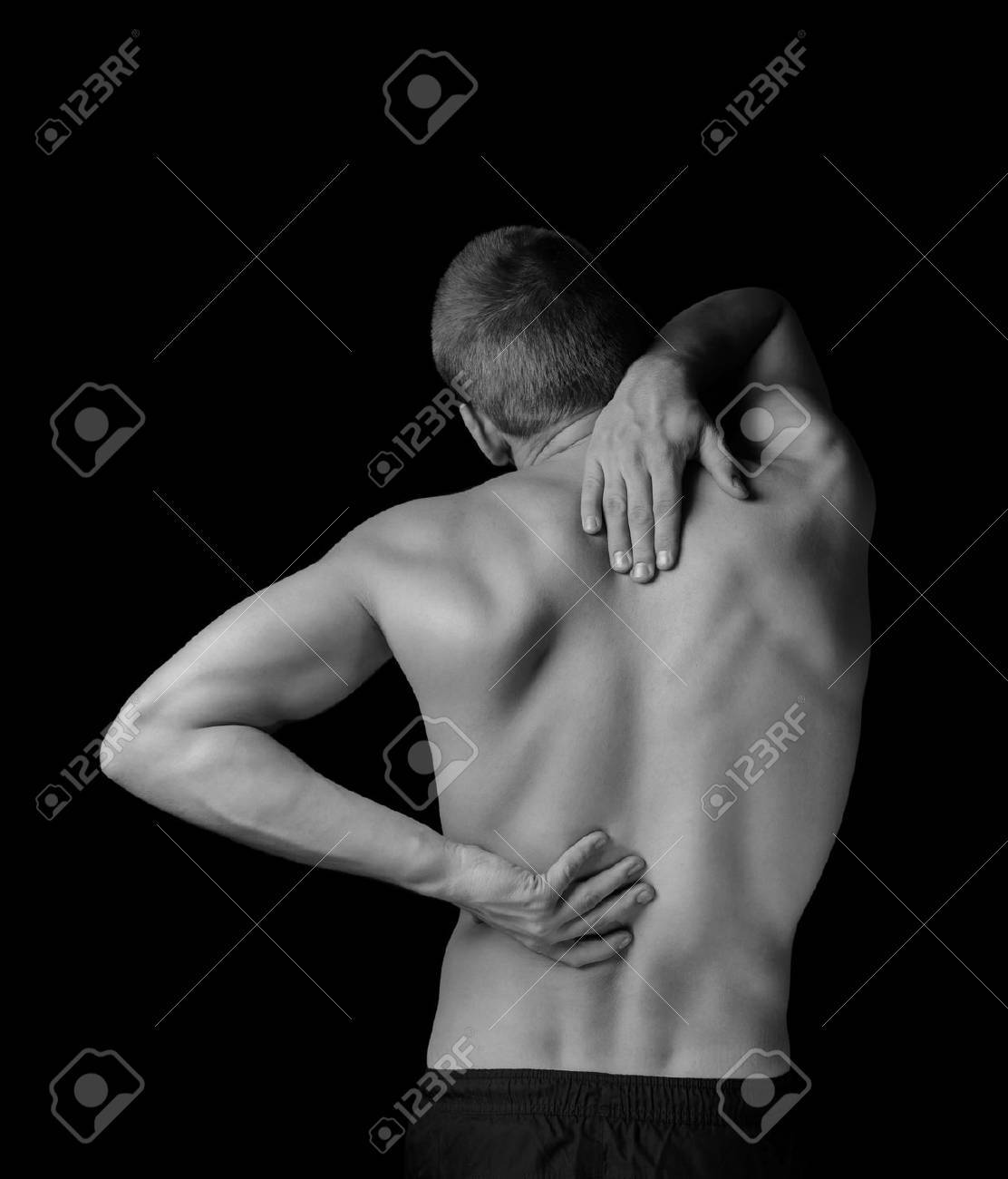 Man is touching the back, concept of pain in the spine, monochrome image - 37763058