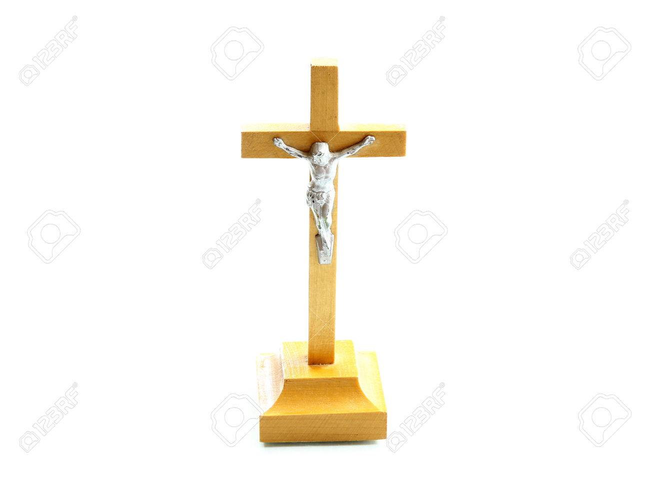 very simple wooden holy crucifix jesus christ on cross white