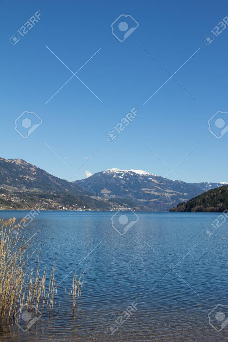 Lake Millstatt View From Westside To Mt. Mirnock In Spring Stock Photo - 38937363