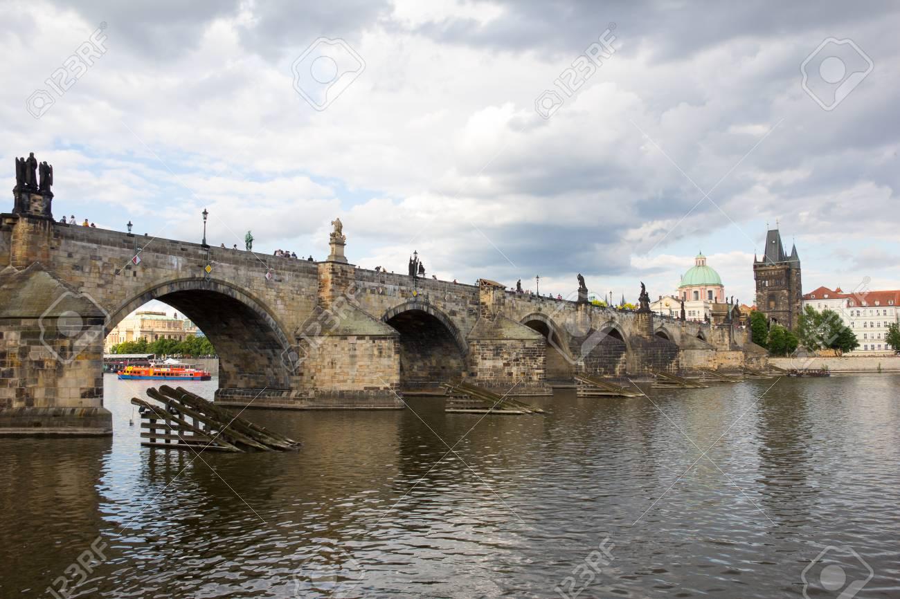 Charles Bridge And Old Bridge Tower At River Vltava In Prague Czech Republic Stock Photo - 60811130