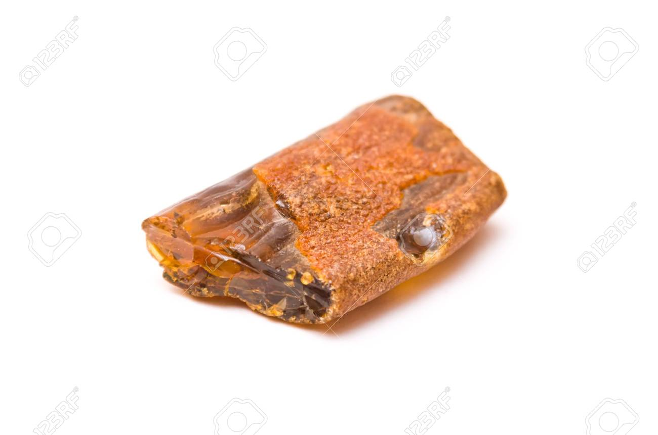 Piece of amber isolated on white background Stock Photo - 5672776