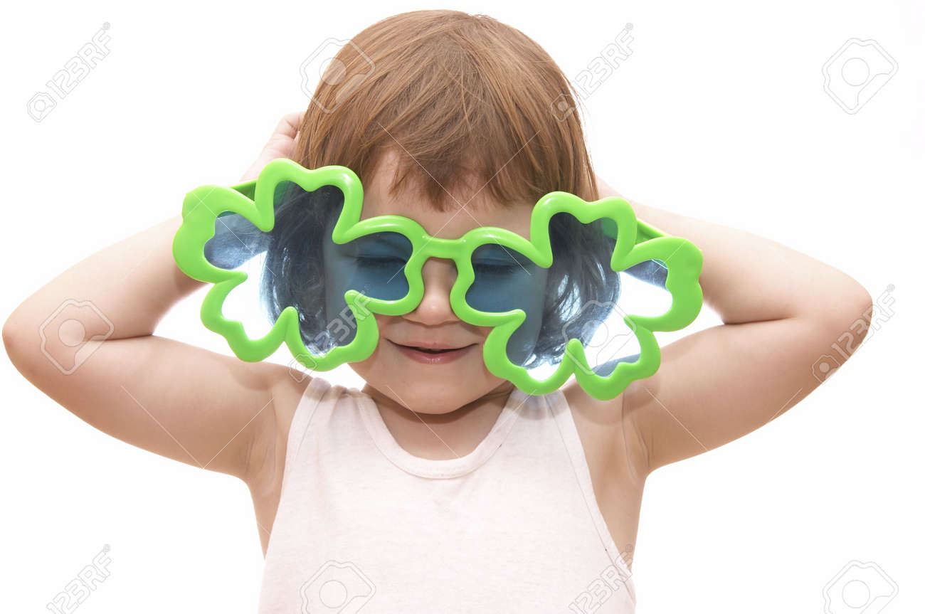 little girl, wearing funny, clover shaped, sunglasses, isolated on white Stock Photo - 956454