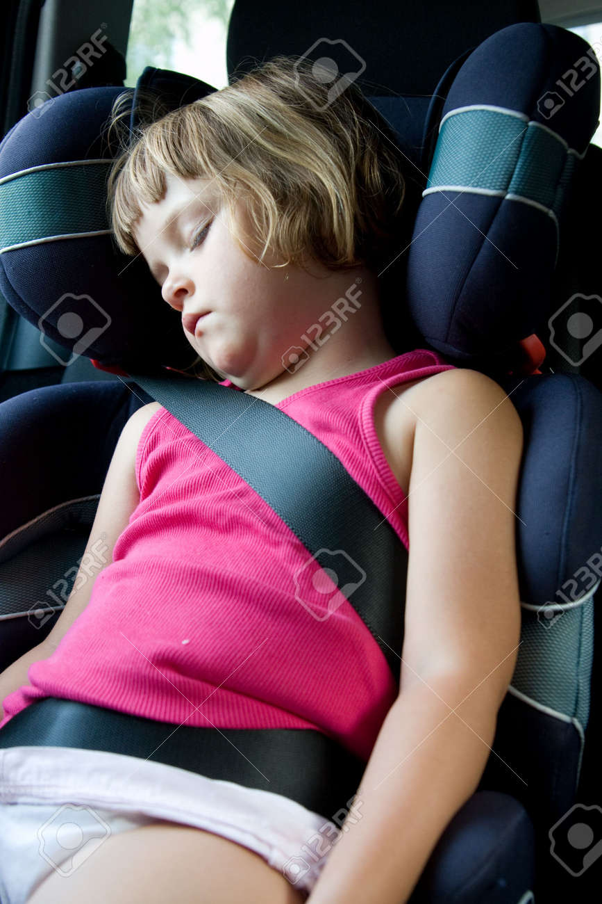 Little Girl Sleeping In Safety Car Seat Stock Photo