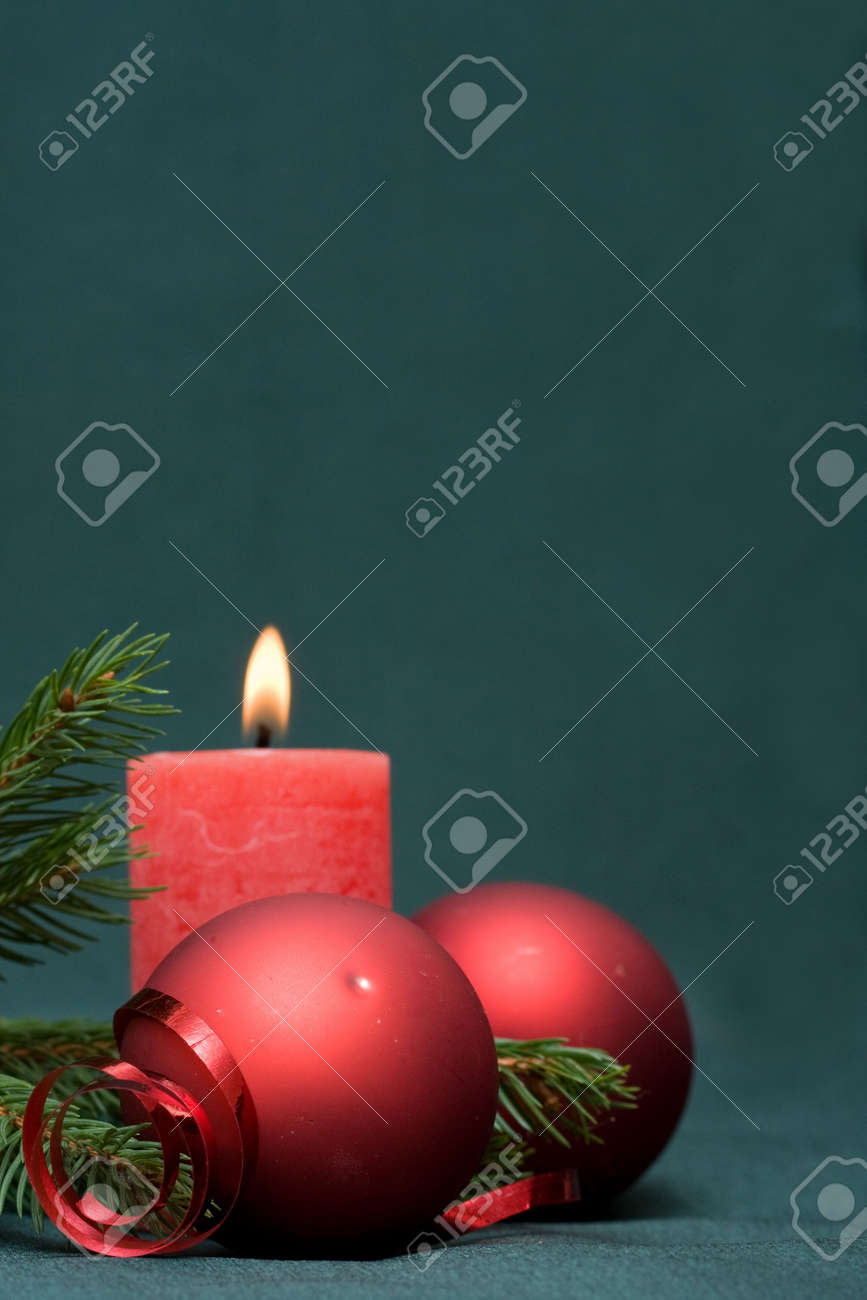 Christmas composition of conifer, red baubles and candle Stock Photo - 3803056