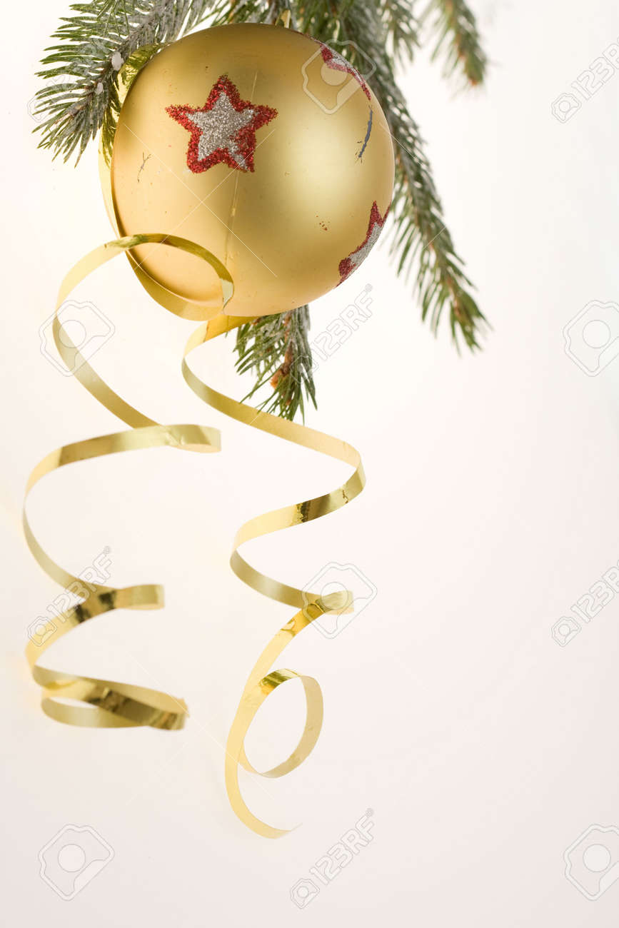 golden bauble, ribbon and spruce twigs on light background Stock Photo - 3850246
