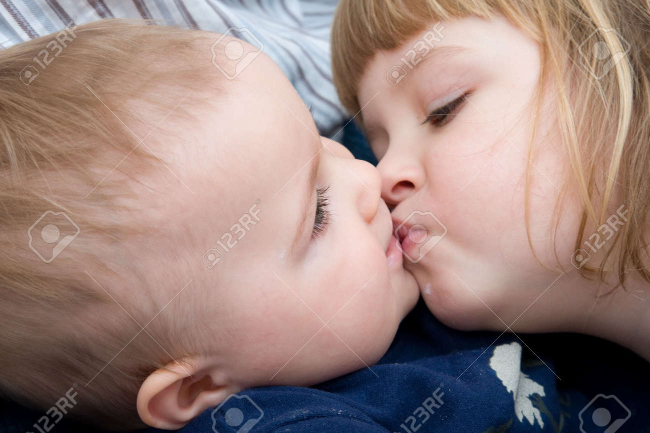 boy-kissing-girl-on-lips-in-a-bath-autism-and-sperm