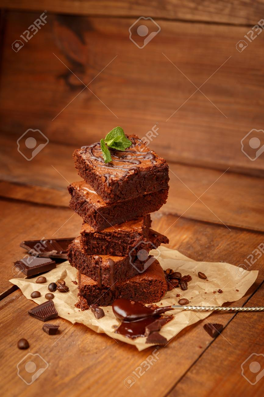 Plate with delicious chocolate brownies on dark vintage wood background. - 52348648