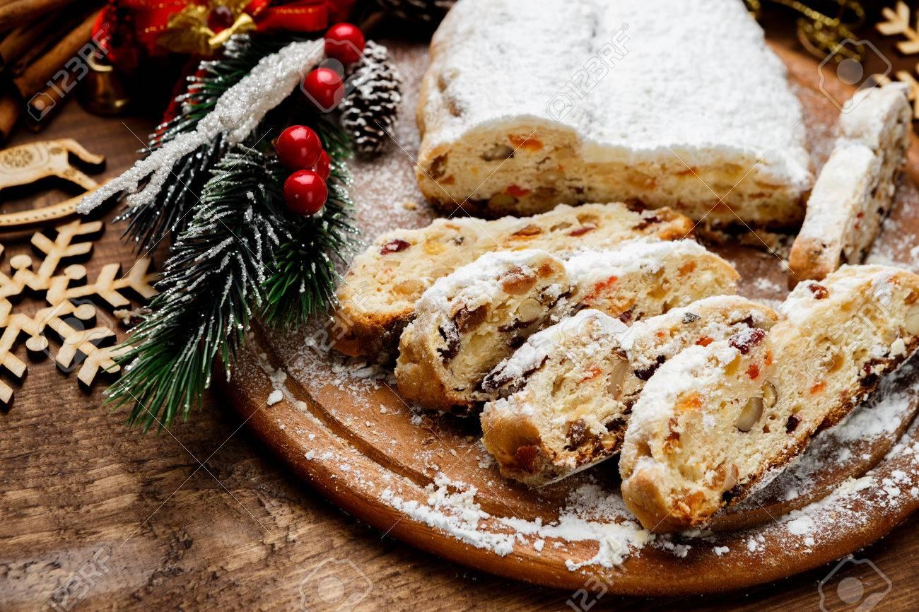 traditional German cake with raisins Dresdner stollen. Christmas treat - 63703170