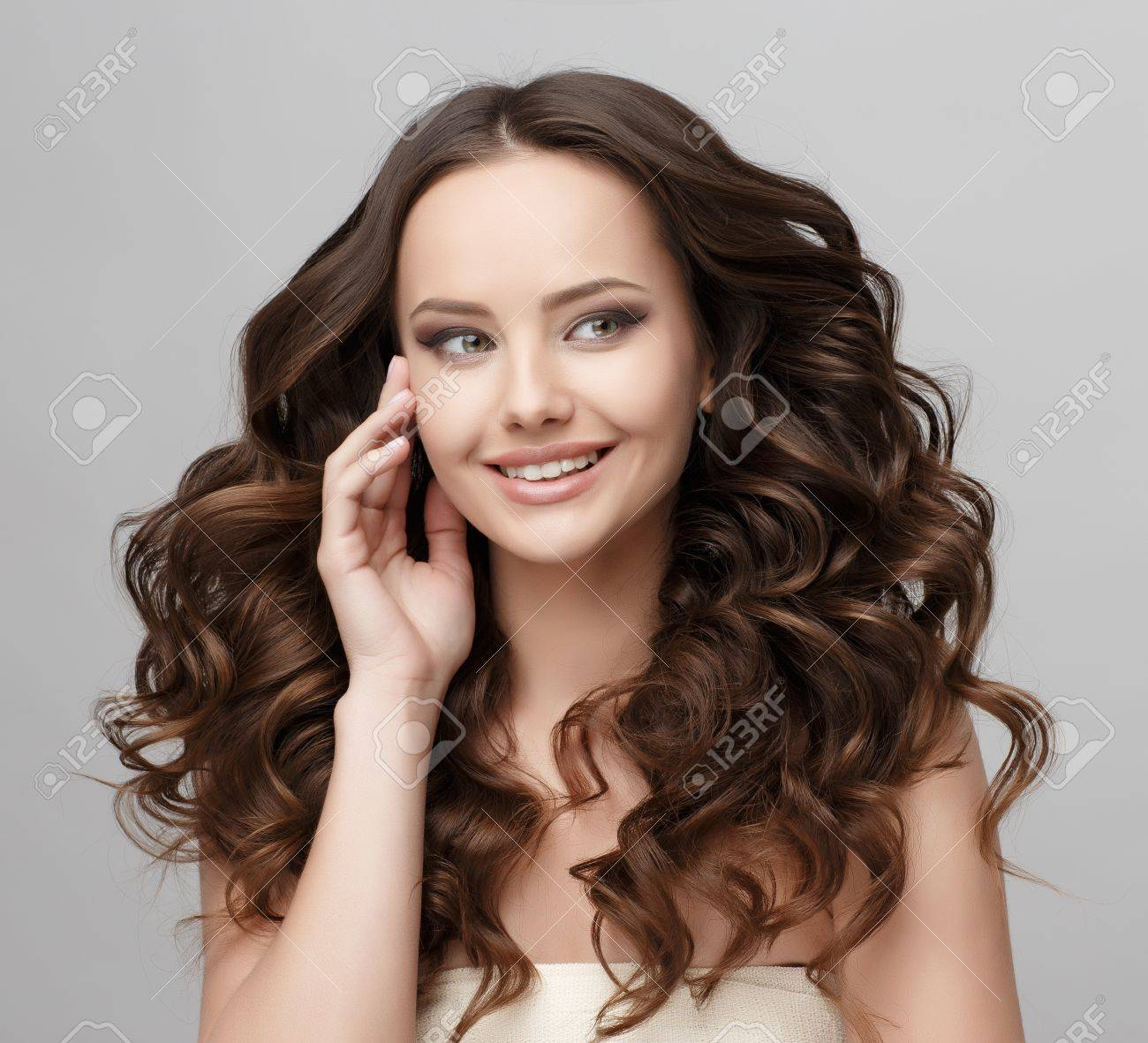 Beautiful Face of Young Woman with Clean Fresh Skin close up isolated on white. Beauty Portrait. Beautiful Spa Woman Smiling. Perfect Fresh Skin. Pure Beauty Model. Youth and Skin Care Concept - 64452027