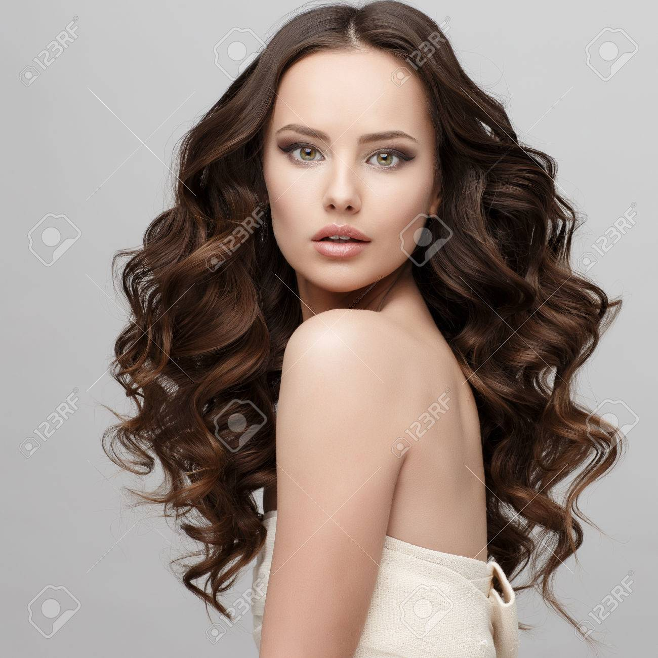 Beautiful Face of Young Woman with Clean Fresh Skin close up isolated on white. Beauty Portrait. Beautiful Spa Woman Smiling. Perfect Fresh Skin. Pure Beauty Model. Youth and Skin Care Concept - 64579712