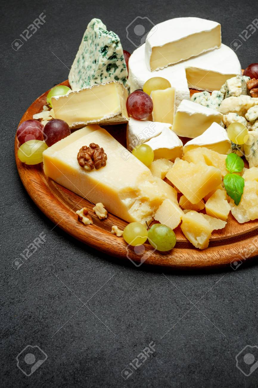 Cheese plate with Assorted cheeses Camembert Brie Parmesan blue cheese goat Stock Photo & Cheese Plate With Assorted Cheeses Camembert Brie Parmesan.. Stock ...
