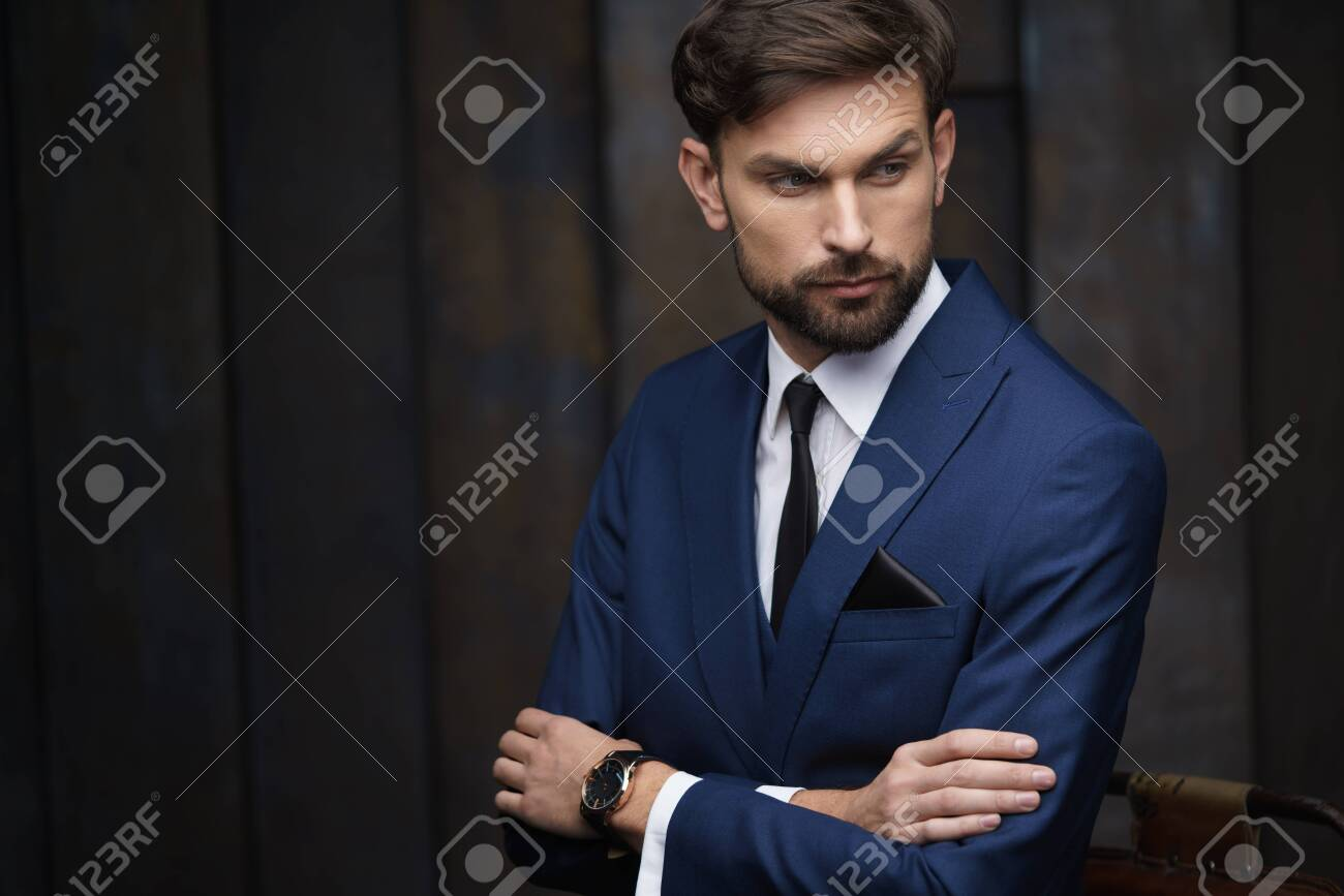indoor photo of young handsome stylish businessman wearing suit - 138527583