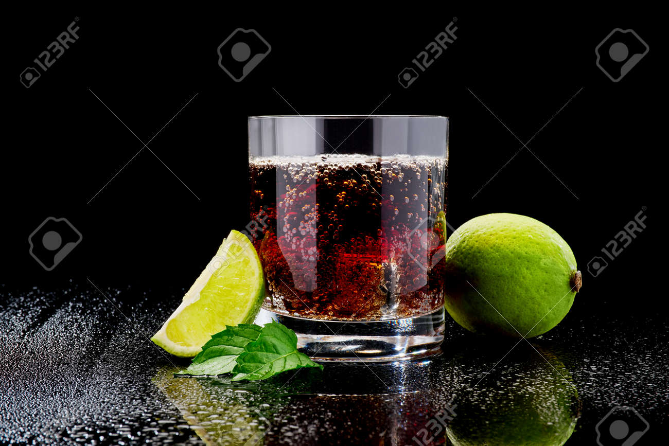 Whiskey with steel cooling cubes on dark glass background - 169835566