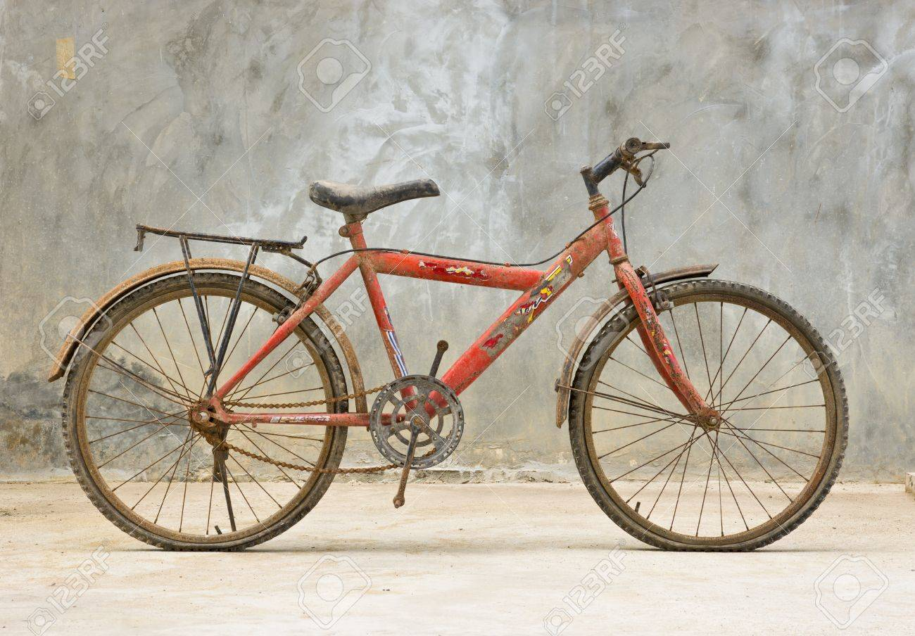 old red bicycle with concrete background Stock Photo - 15303608
