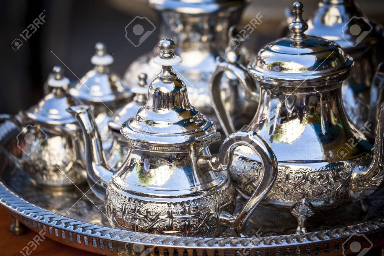 Stock Photo - Table setting with silver tableware and dates. Oriental hospitality concept with tea or coffee cups & Table Setting With Silver Tableware And Dates. Oriental Hospitality ...
