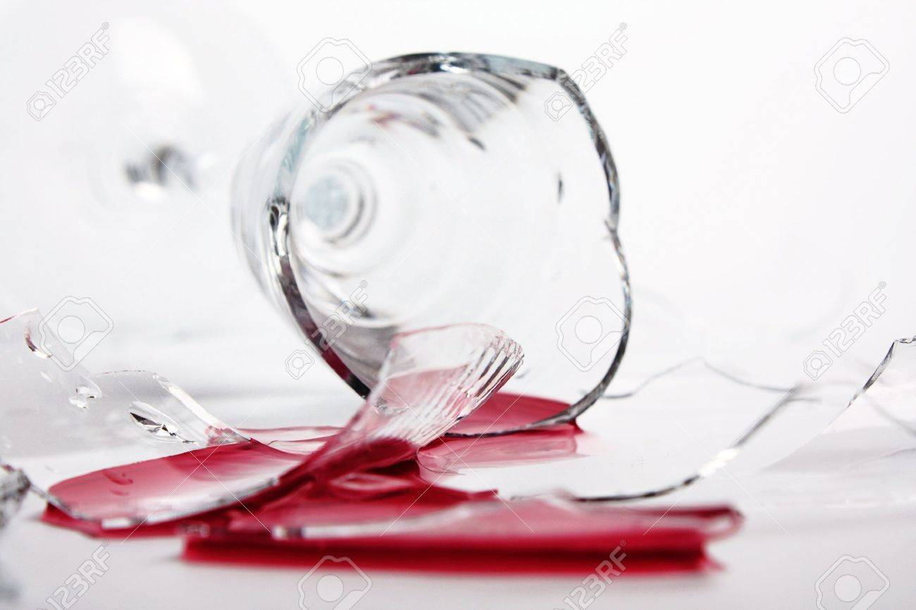 Broken wineglass on the table. Poured red wine, like blood. - 7540752