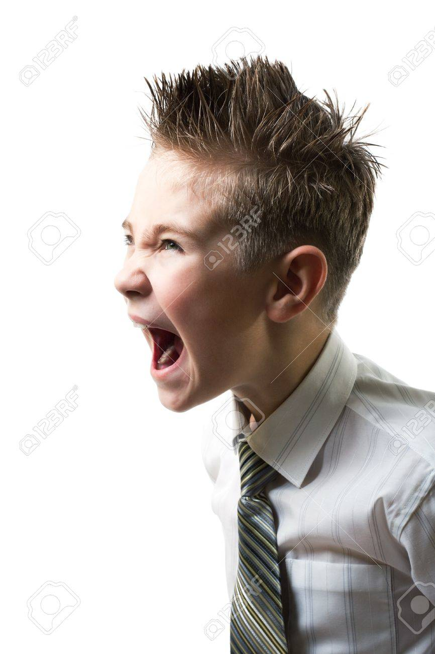 Ten year young child screaming with angry face expression isolated on white Stock Photo - 8292827