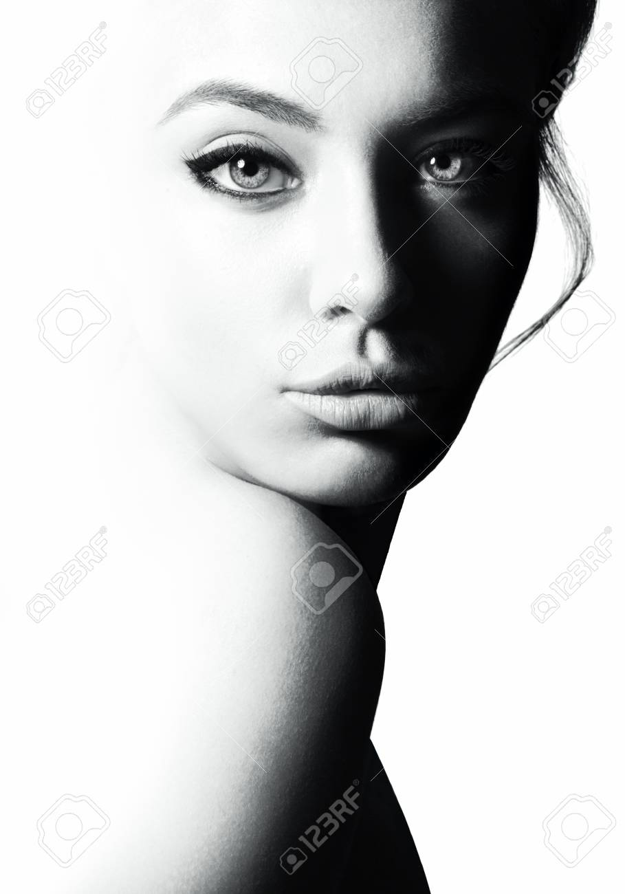 High contrast black and white portrait of a beautiful girl stock photo 91087764