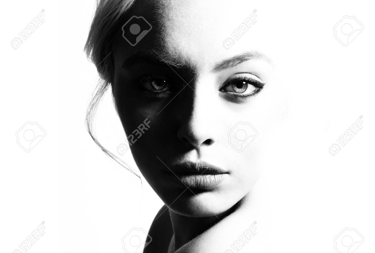 High contrast black and white portrait of a beautiful girl stock photo 101039136