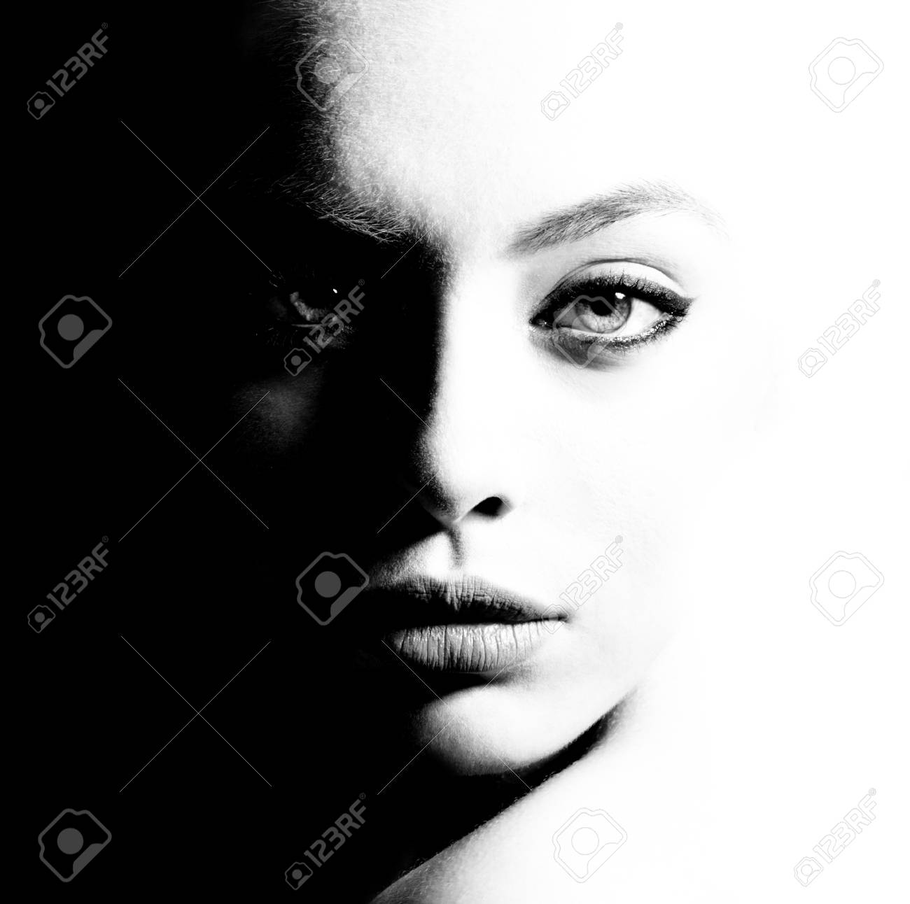 High contrast black and white portrait of a beautiful girl stock photo 101039137