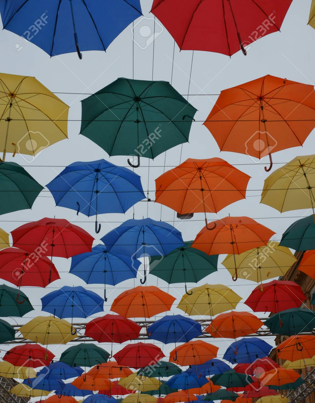 4466a83d5 Bright, beautiful, colored umbrellas on a cloudy sky background Stock Photo  - 80960199