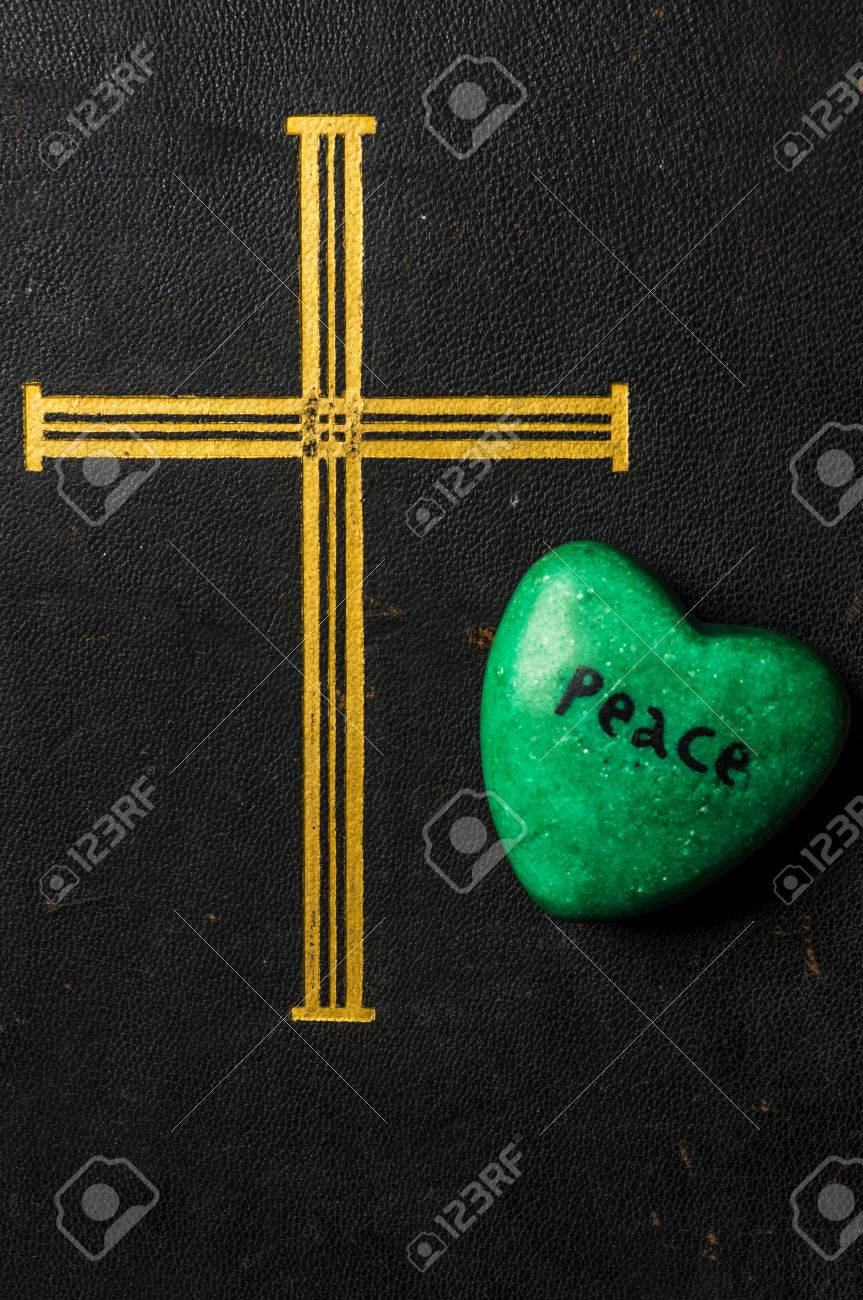Catholic Religion And Peace Concept Represented By An Old Bible Cover A Green