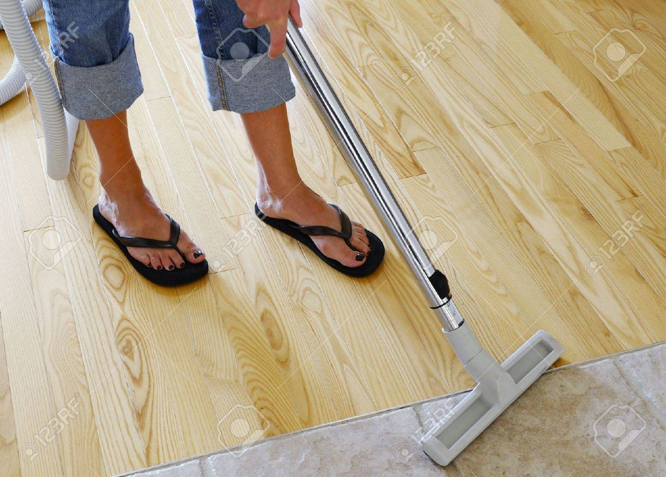 Awesome Woman Cleaning Hardwood And Tile Floor With Central Vacuum Cleaner Stock  Photo   3387971