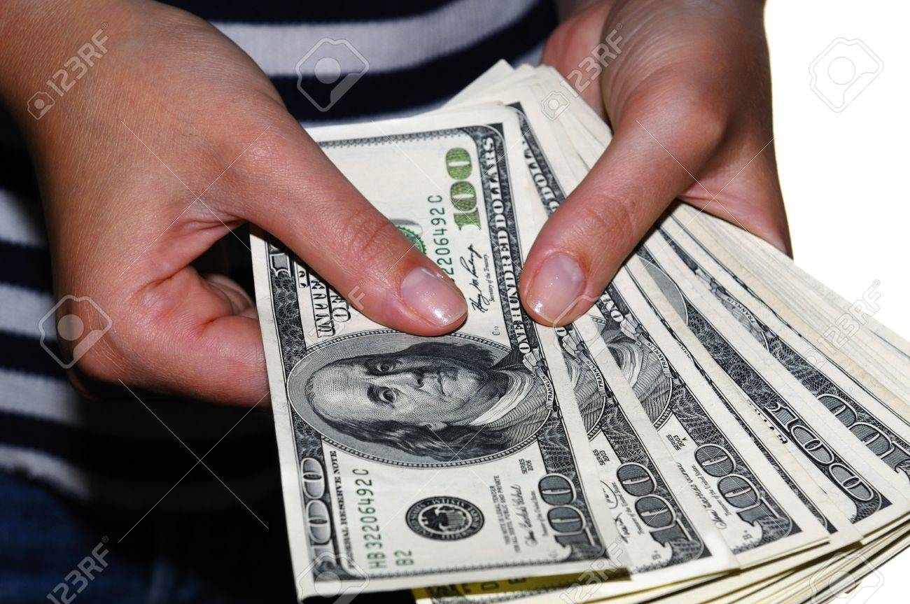 worksheet Counting Dollar Bills womans hand counting hundred dollar bills stock photo picture 3519598