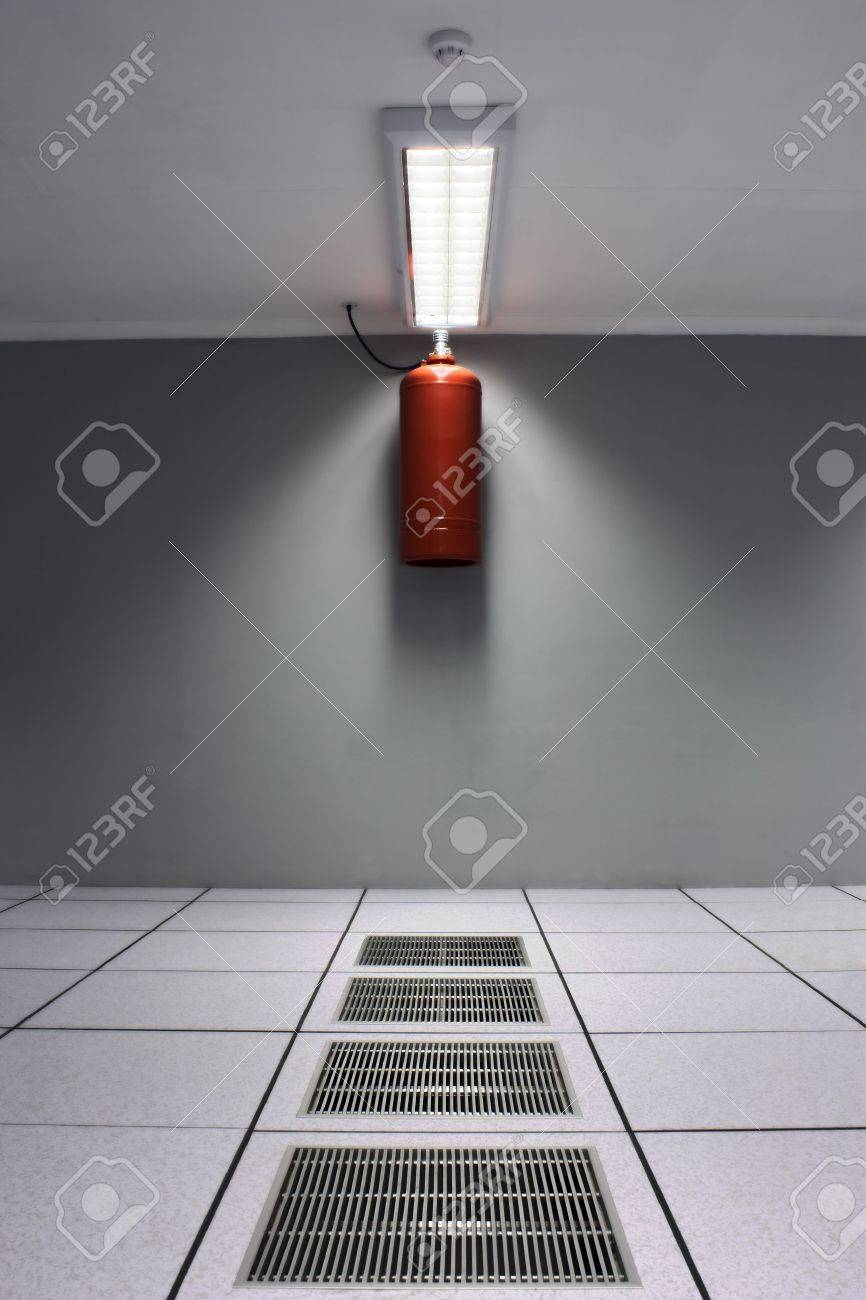 A dreamy shot of a server/data center with airconditioner grids and a fire suppression system including FM200 safe gas bottle and a smoke detector. Stock Photo - 5662502