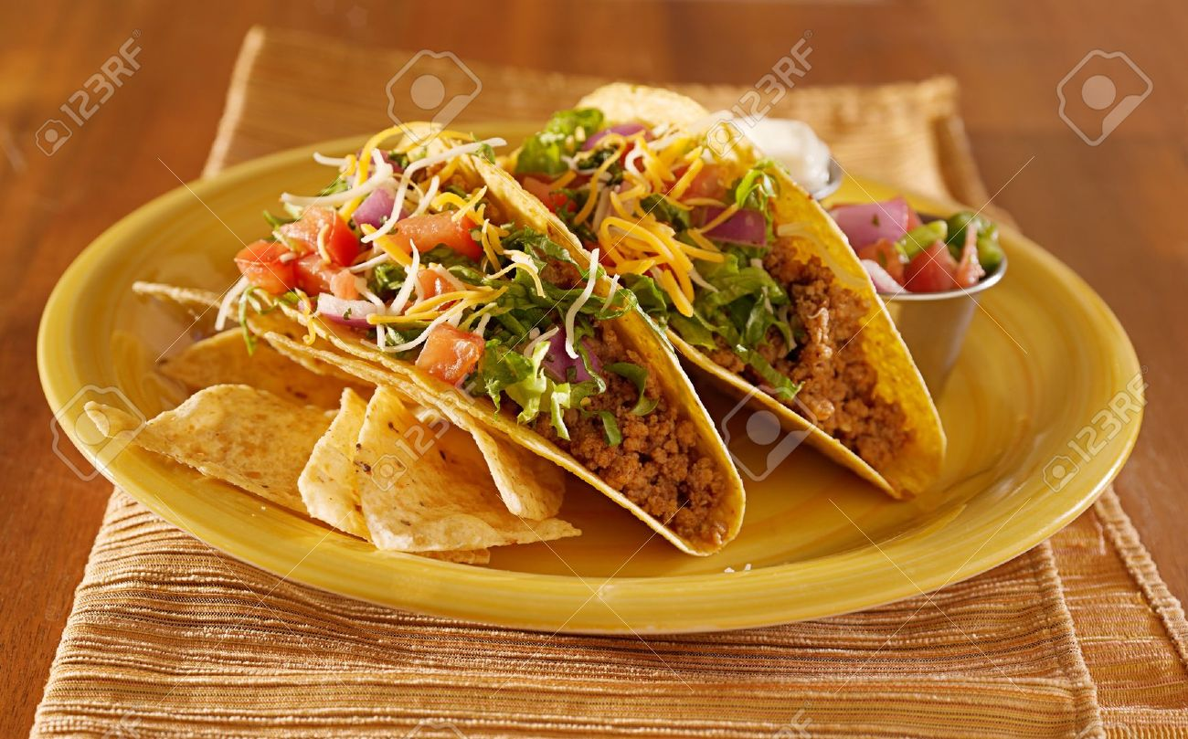 Tacos on a platter with tortillas - mexican food Stock Photo - 14940559