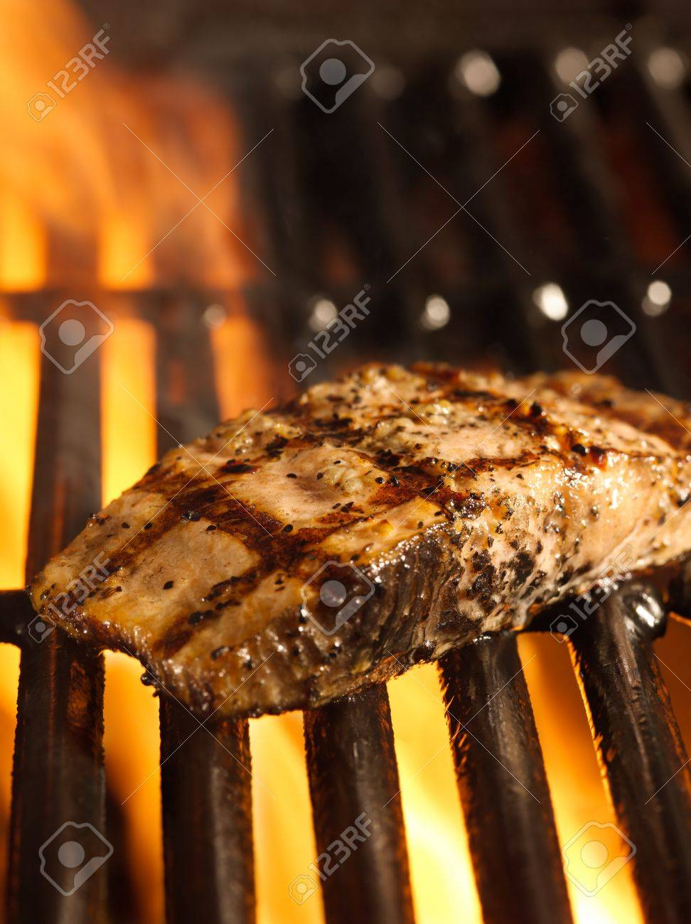 salmon fillet on the grill with flames Stock Photo - 14941004
