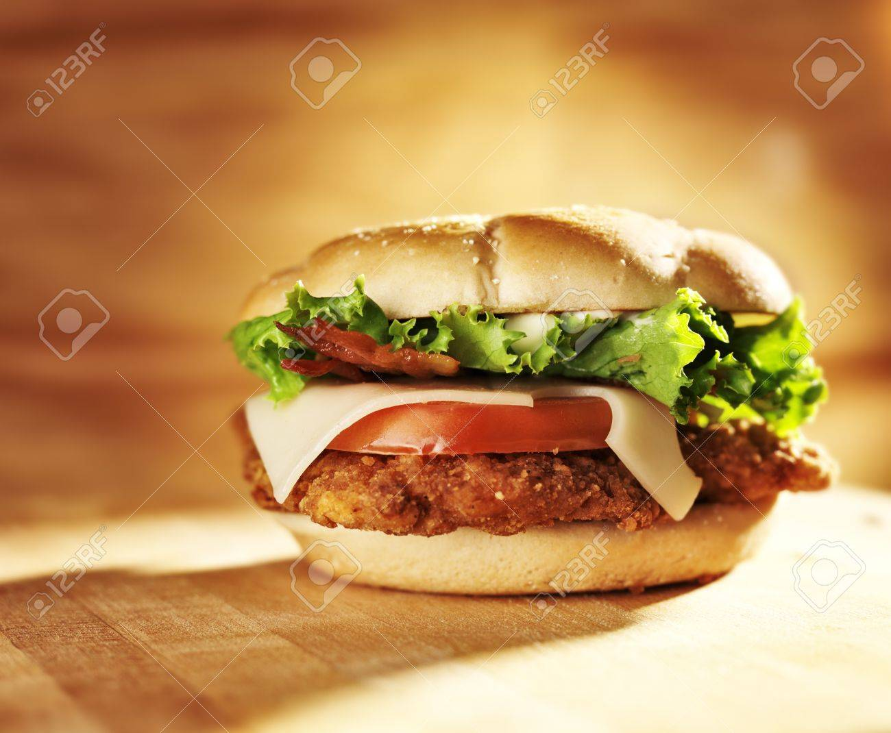 crispy chicken sandwich with bacon and swiss cheese. Stock Photo - 15399781
