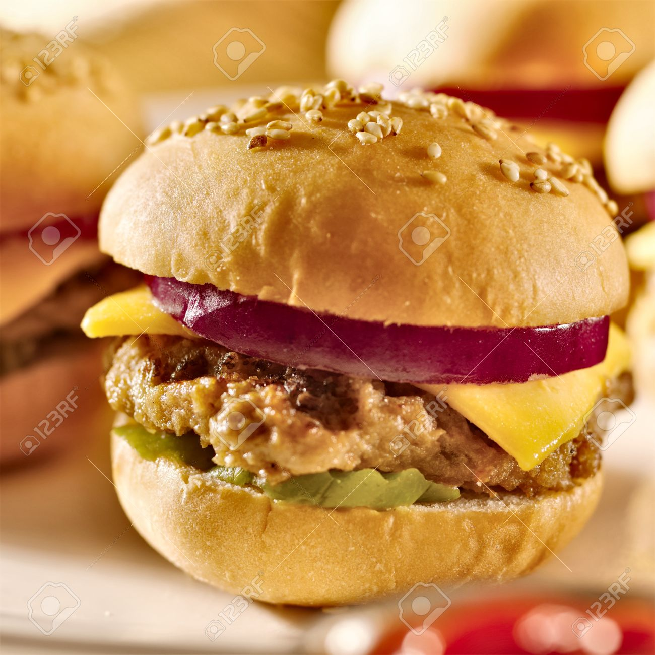 mini burgers with cheese, onion and pickle - 15529364