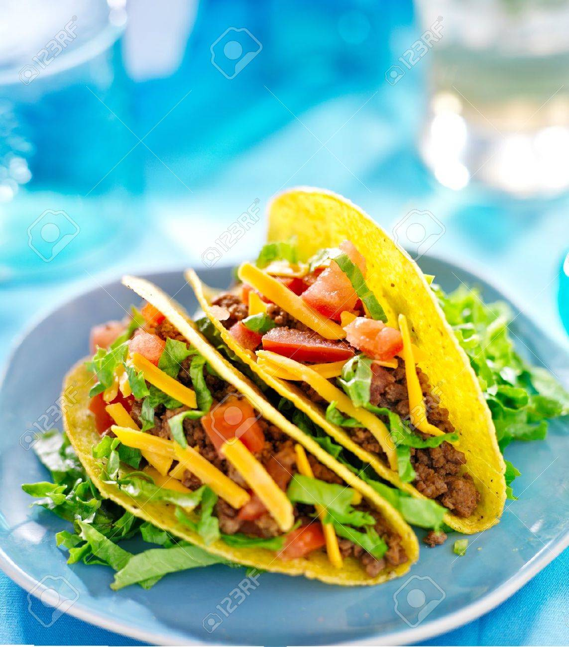 Mexican food - Hard shell tacos with beef, cheese, lettuce and tomatoes Stock Photo - 19424832