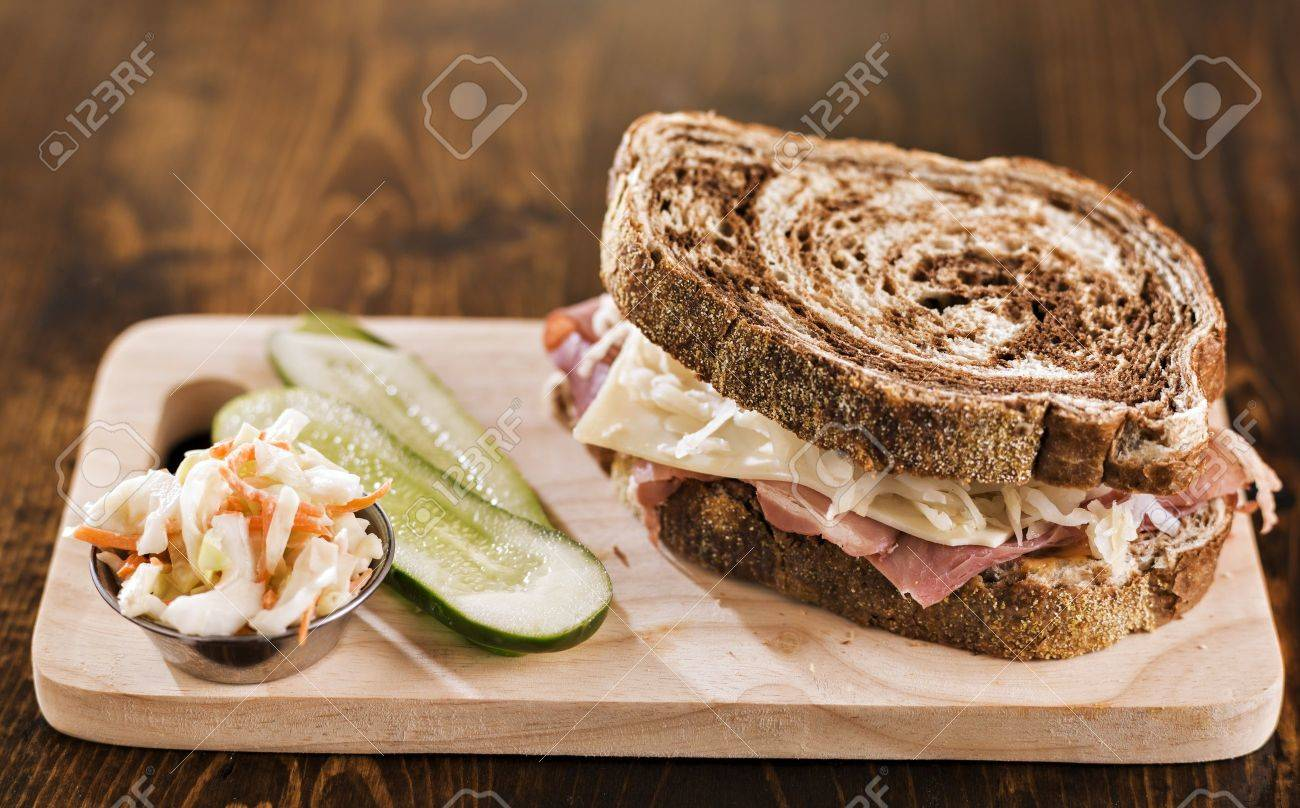 reuben sandwich with kosher dill pickle and coleslaw - 19798495