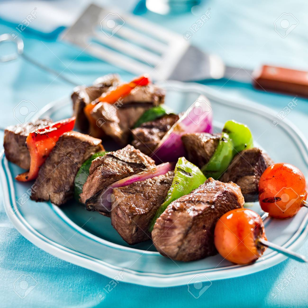 grilled beef shishkabobs on table Stock Photo - 21585413