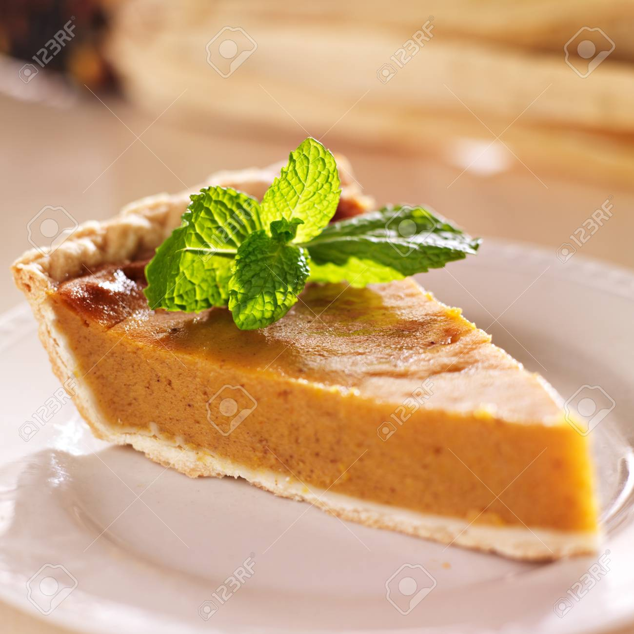 pumpkin pie with mint garnish closeup Stock Photo - 21957508