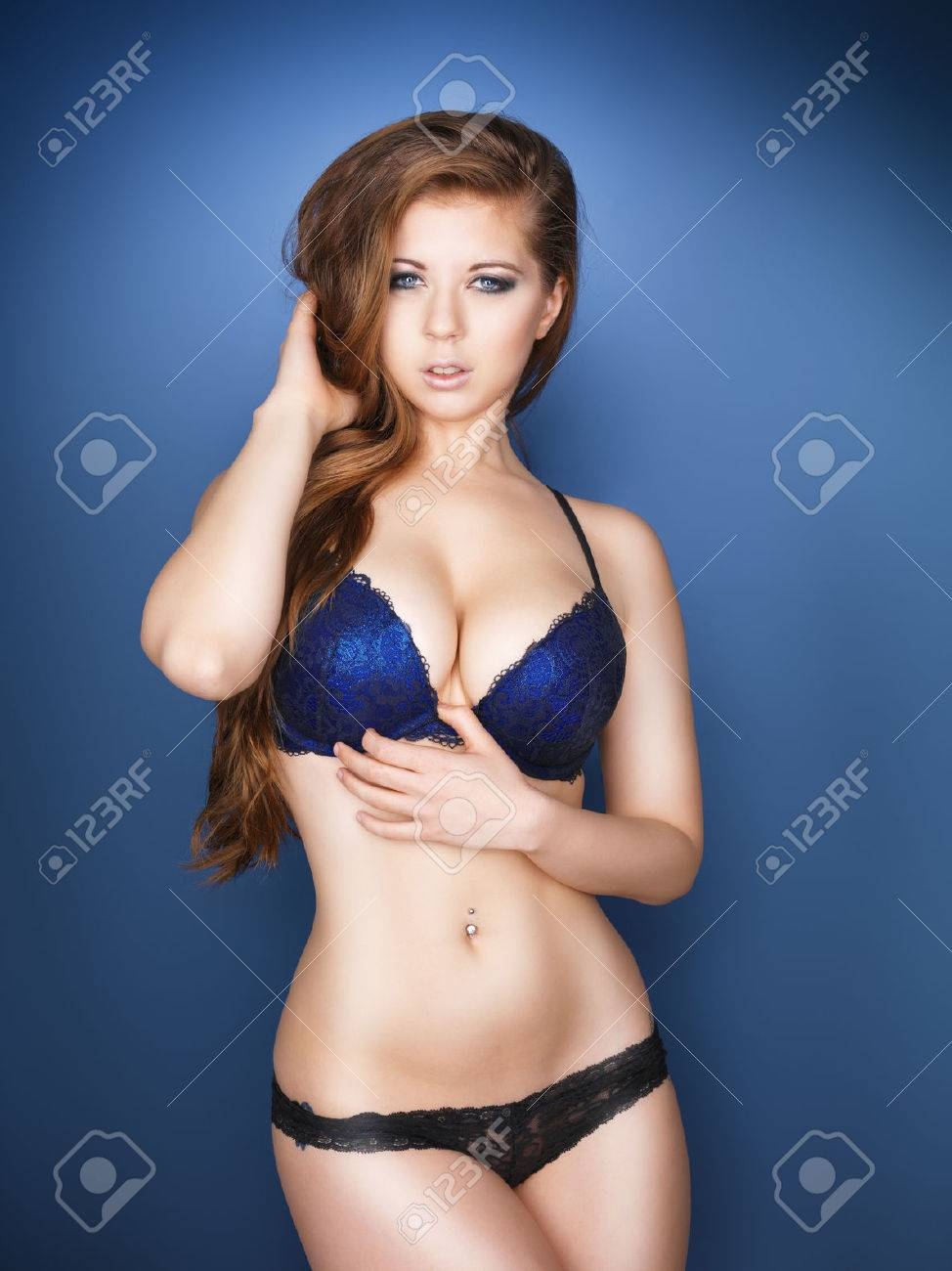 Beautiful sexy model with large breasts and blue eyes Stock Photo - 23421532