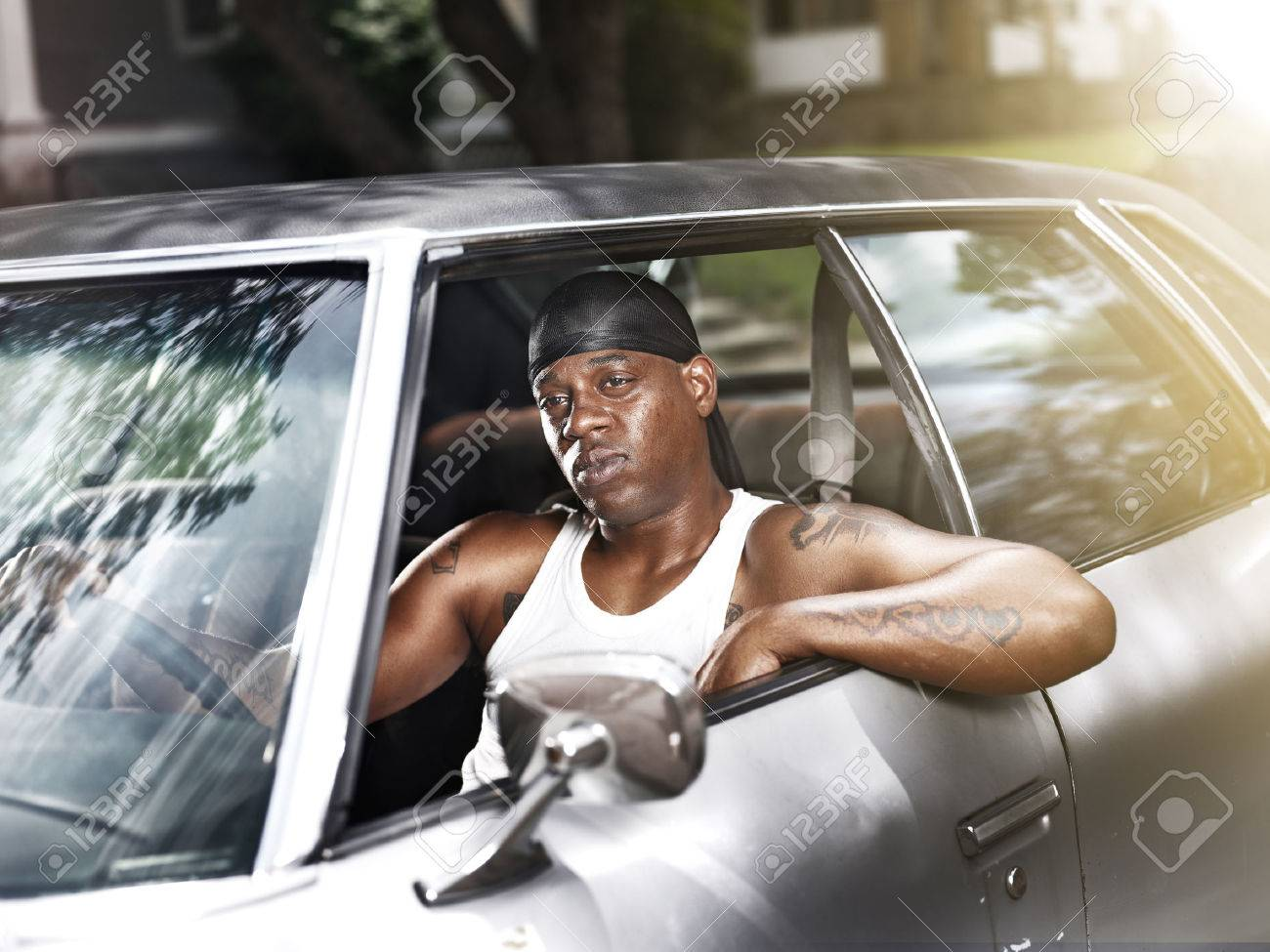 Cool African Man In Car Wearing Wife Beater And Dew Rag Stock Photo    26232346