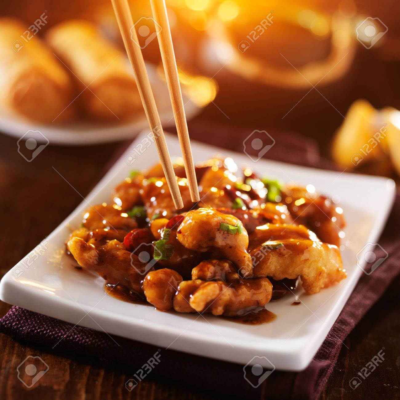 chinese take out food - eating general tso's chicken with chopsticks - 32754367