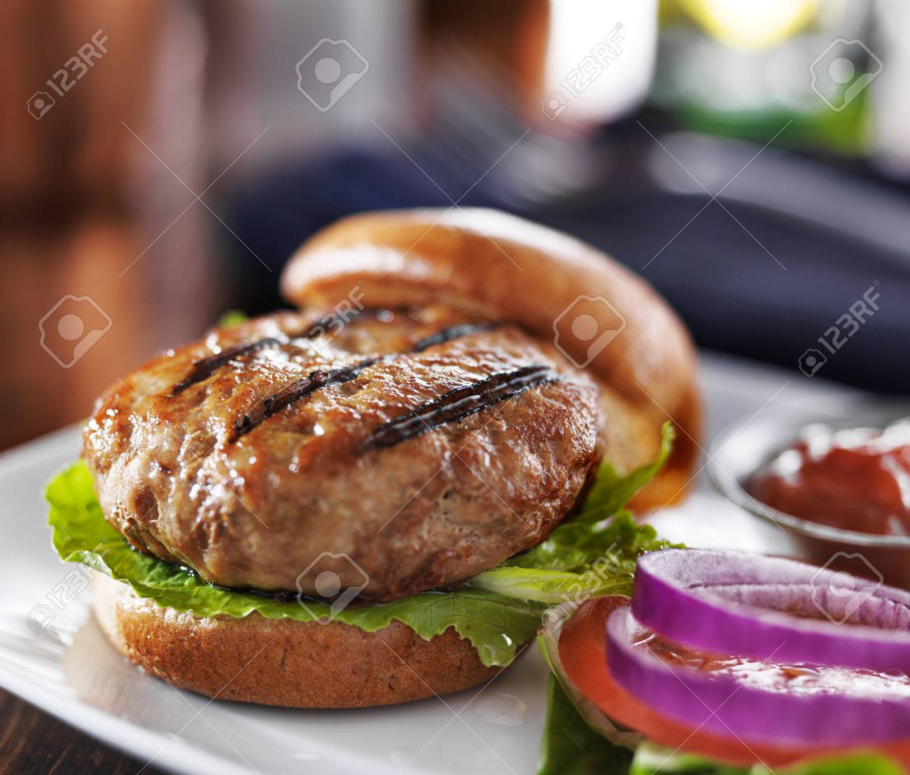 turkey burger on bun with lettuce and fixings - 35534128